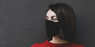 consumer with face mask